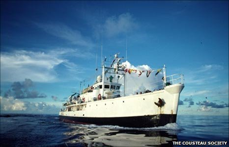 Image shows Jacques Cousteau's research ship Calypso on the open sea.